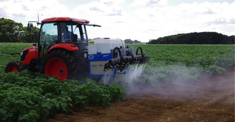 Hero image for news page tractor spraying onto a field